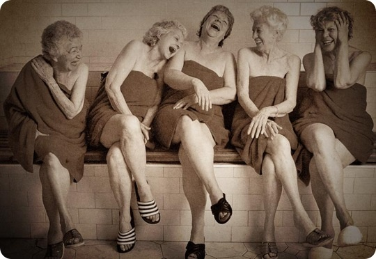 older women in sauna laughing